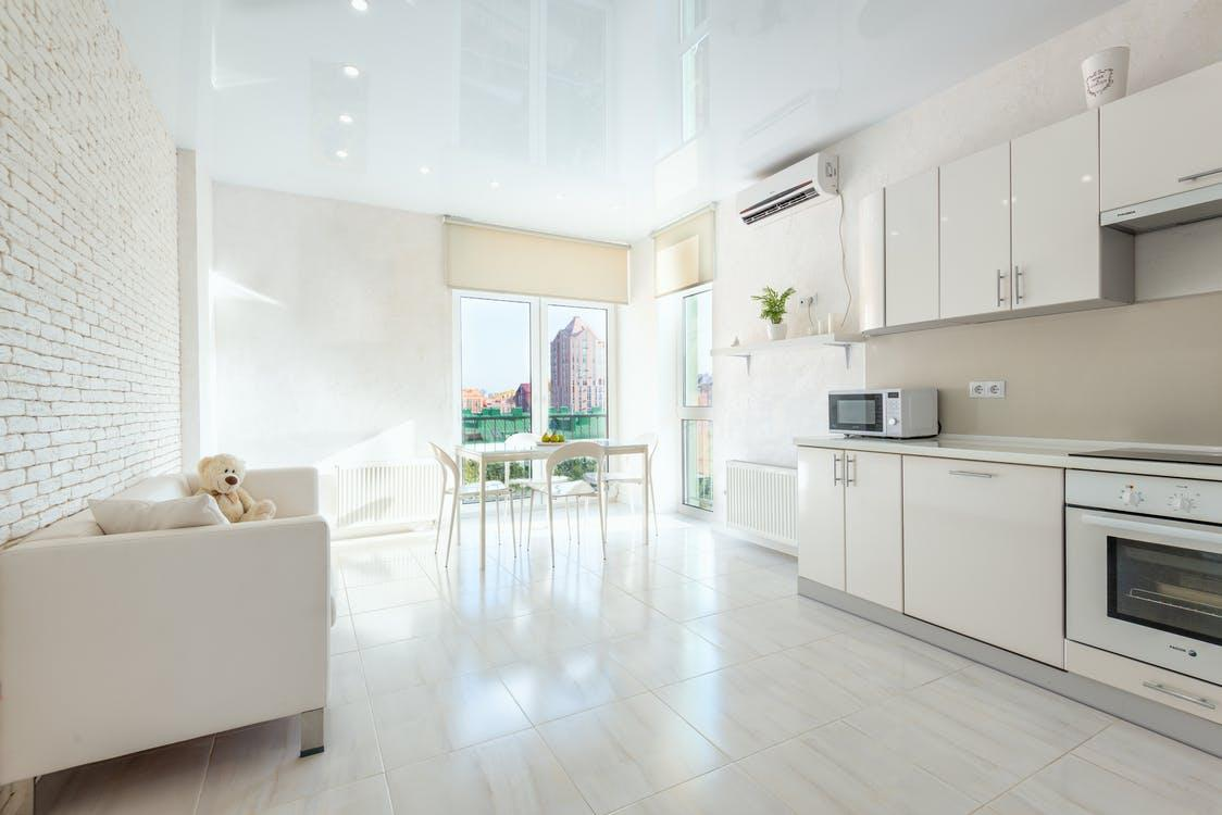 Common Air Conditioning Mistakes People Make. Pastel color palette for modern styled studio apartment with the sense of space