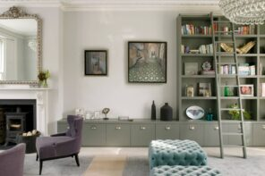 Multi-Function: How To Make Your Apartment Suitable for More Than Just Sleeping. Successful combination of gray furniture and white walls in classic Scandinavian and English styled living room with quilted ottomans