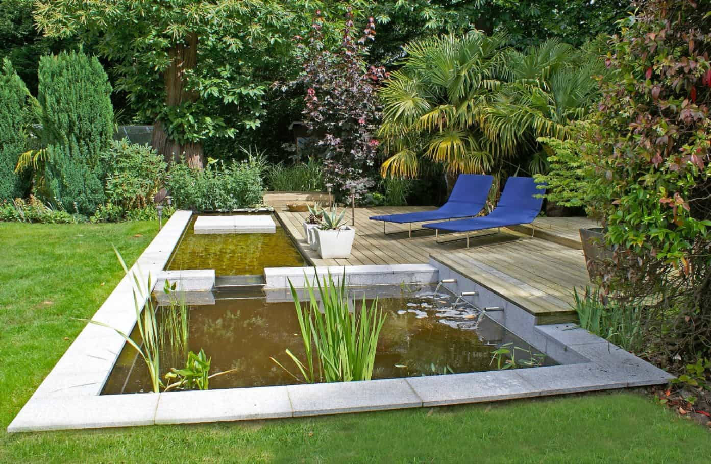 Make Your Garden Your Favorite Hangout Spot. Great landscaping design with ponds and two chaise lounge chairs