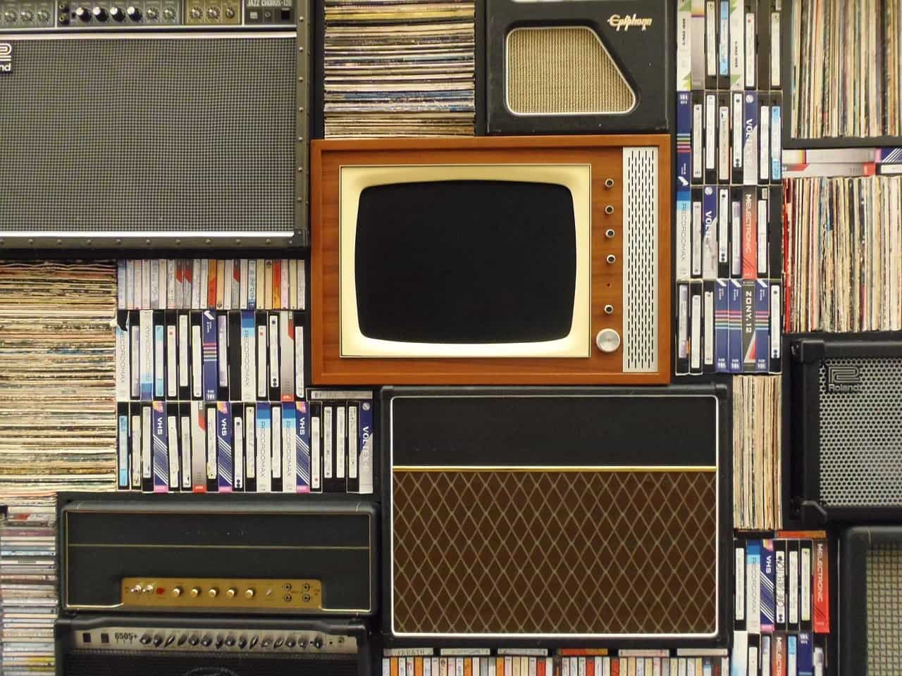 Expert Decorating Tips to Give Your Home a Vintage Look. TV and journals at the shelving