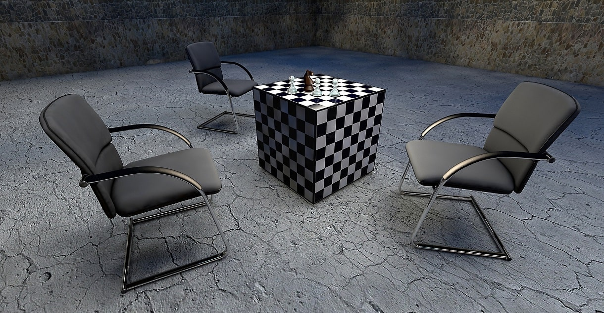 The Importance of Having a Good Quality Chair. Chessboard cube in the center surrounded by gray metal-framed chairs