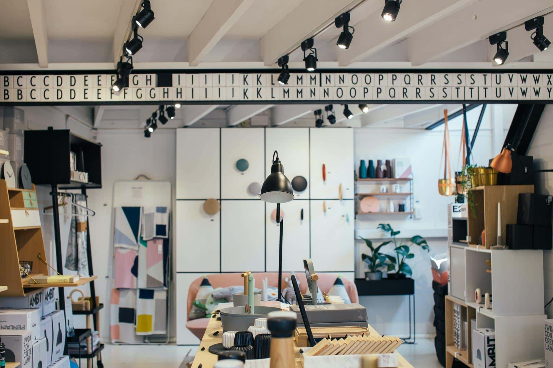 Home Improvements: How To Handle A Chaotic Garage. Contemporary interior finish with balck swivel lamps on metal guides and with storage cabinet