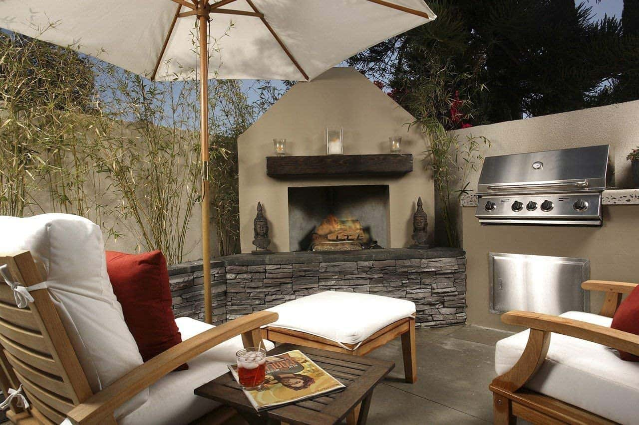 Home Improvement Ideas That Add Value. Great outdoor barbecue zone with parasol and stone cladded stove
