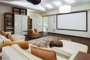 4 Makeover Tips For Creating The Perfect Home Theater Design. White colored interior in casual style with brown floor and furniture inclusions