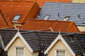 Important Steps to Take Before Installing A New Roof. Ceramic shingles of the roofs in the old European city center