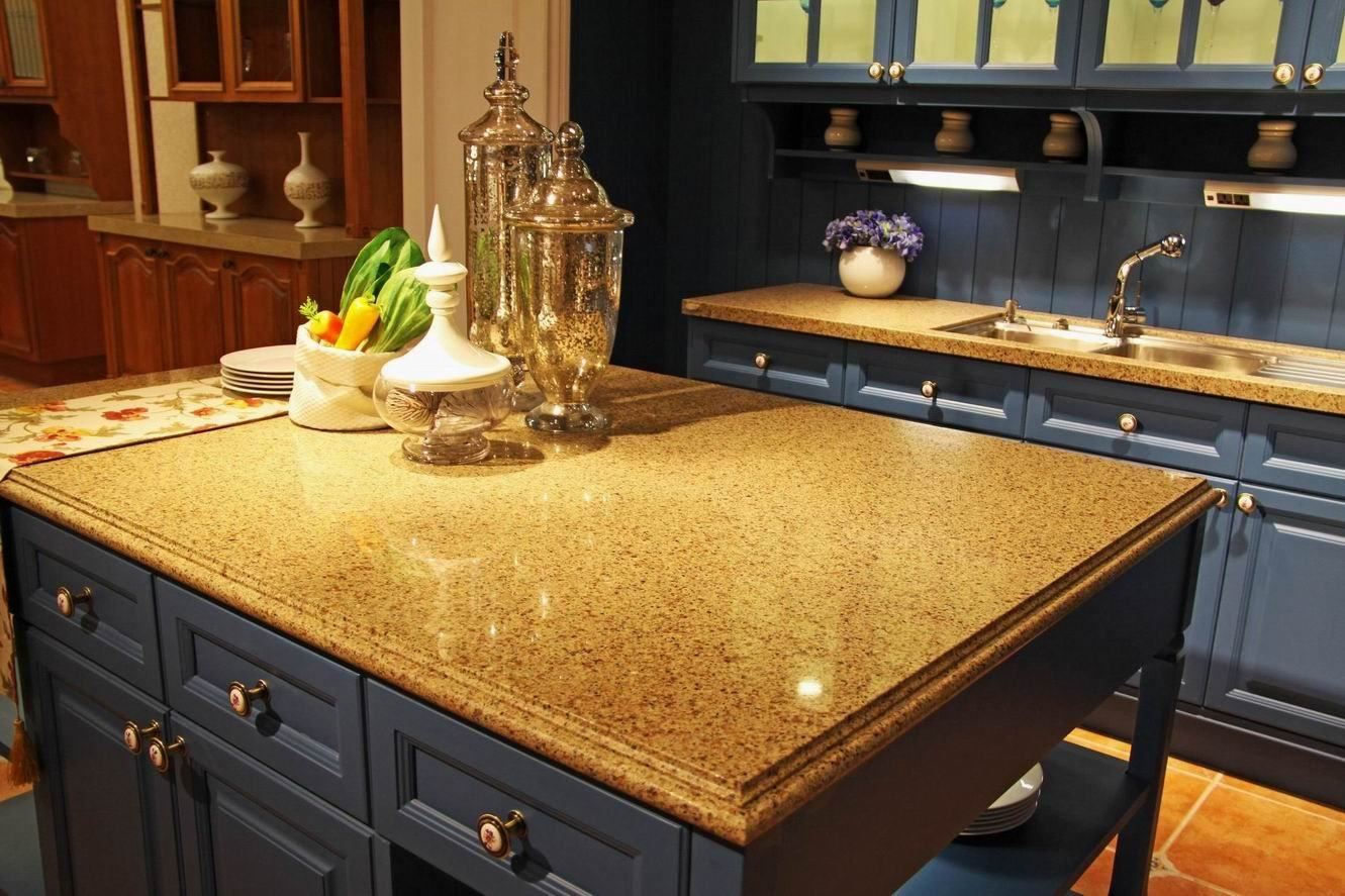Kitchen Countertop Types, Design Options, and Usage Parameters. Glossy light colored stone top and Classic dark blue furniture