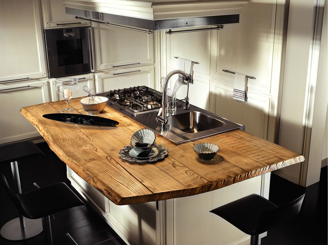 Kitchen Countertop Types, Design Options, and Usage Parameters. Kitchen island with wooden top and large area for butcher block