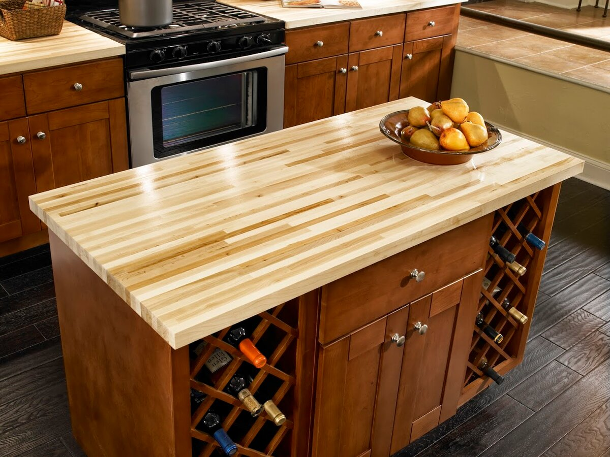 Nice laminated timber countertop of light wooden species for classic kitchen interior