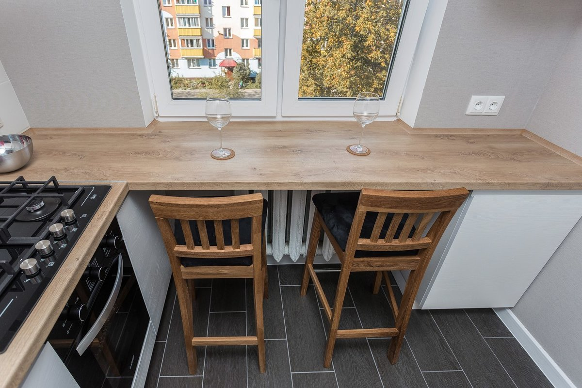 Wooden contertop also is a windowsill for small kitchen