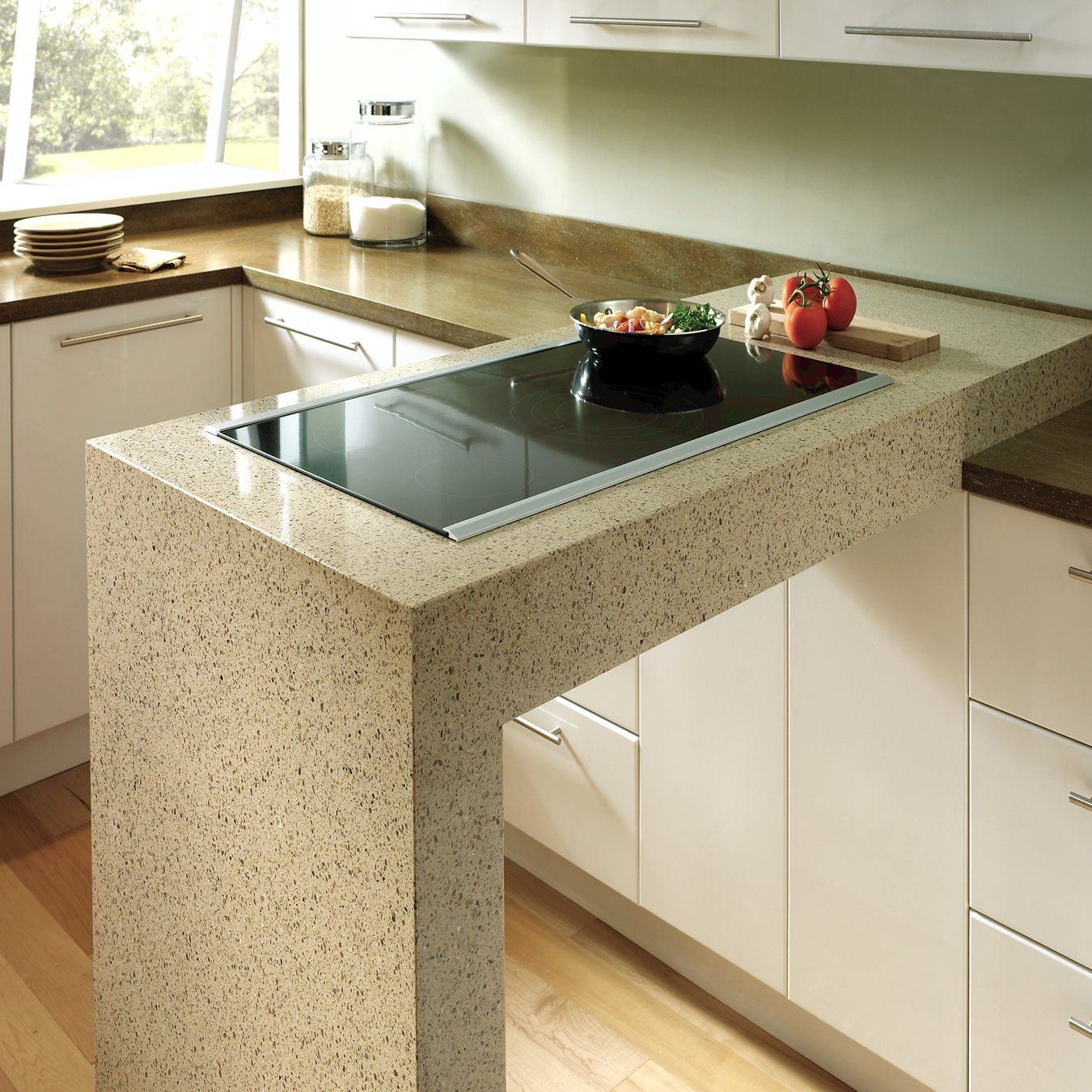 Marble grain material trimmed bar counter in small pastel colored kitchen