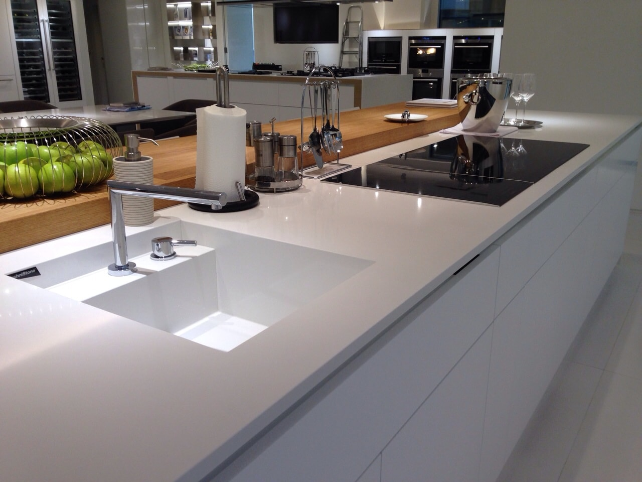 Ultramodern design of the kitchen with two zones and different countertops with direct lighting and mortise sink