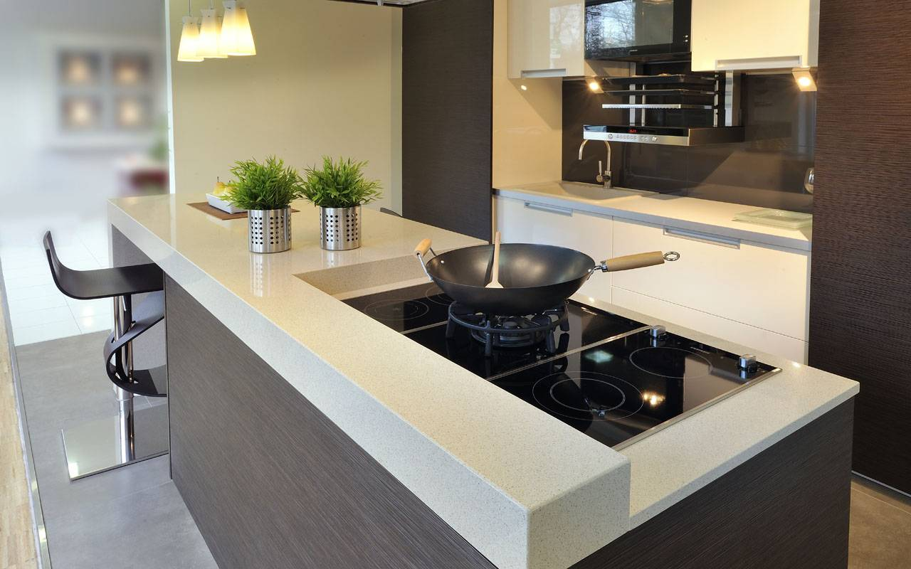 Modern designed kitchen top with different levels and built-in hob