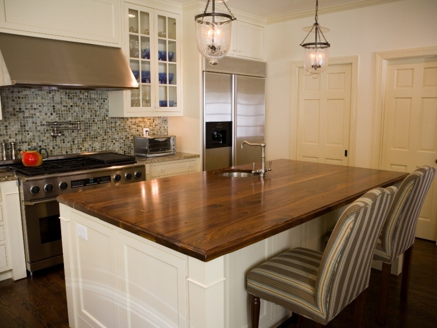 Kitchen Countertop Types, Design Options, and Usage Parameters. Chalet and Scandi mix of interior styles and the polished kitchen island in the center of the room