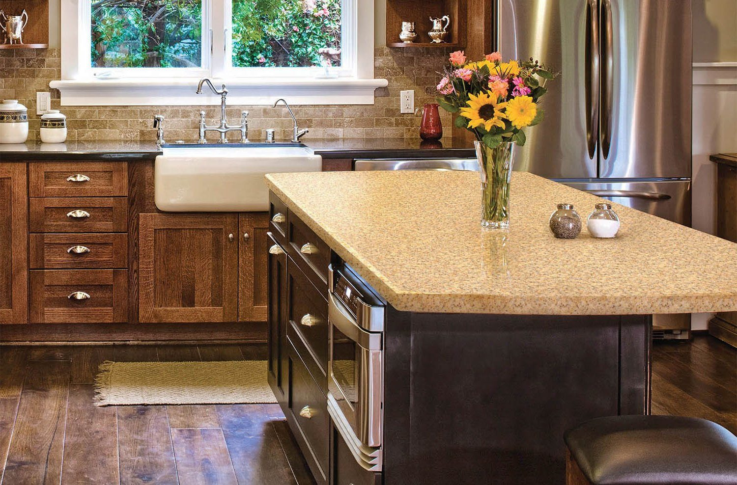 Dark wooden kitchen furniture with touch of French Provence in the form of mortise ceramic sink with classic taps