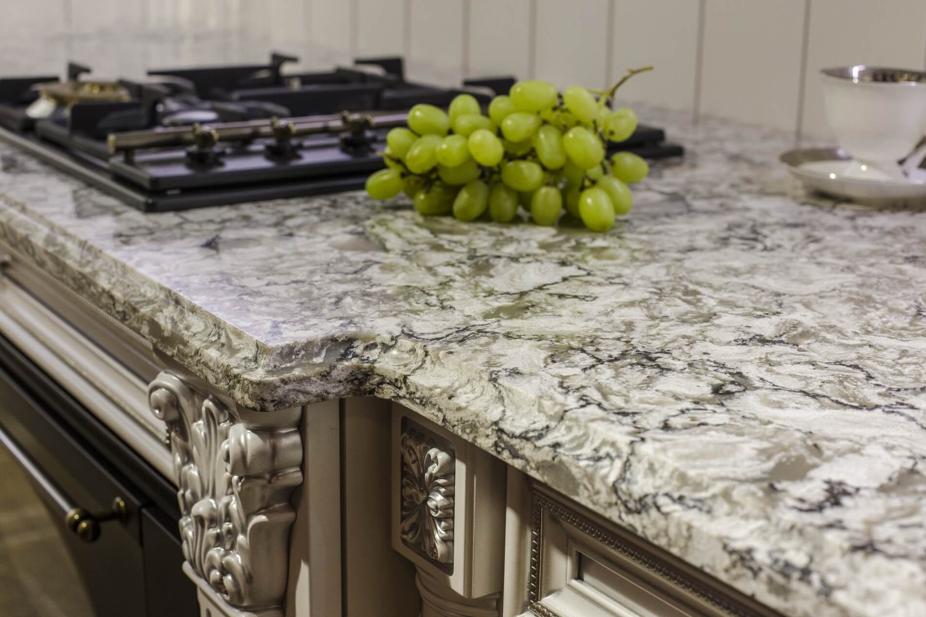 Carved kitchen cabinets and white marble top
