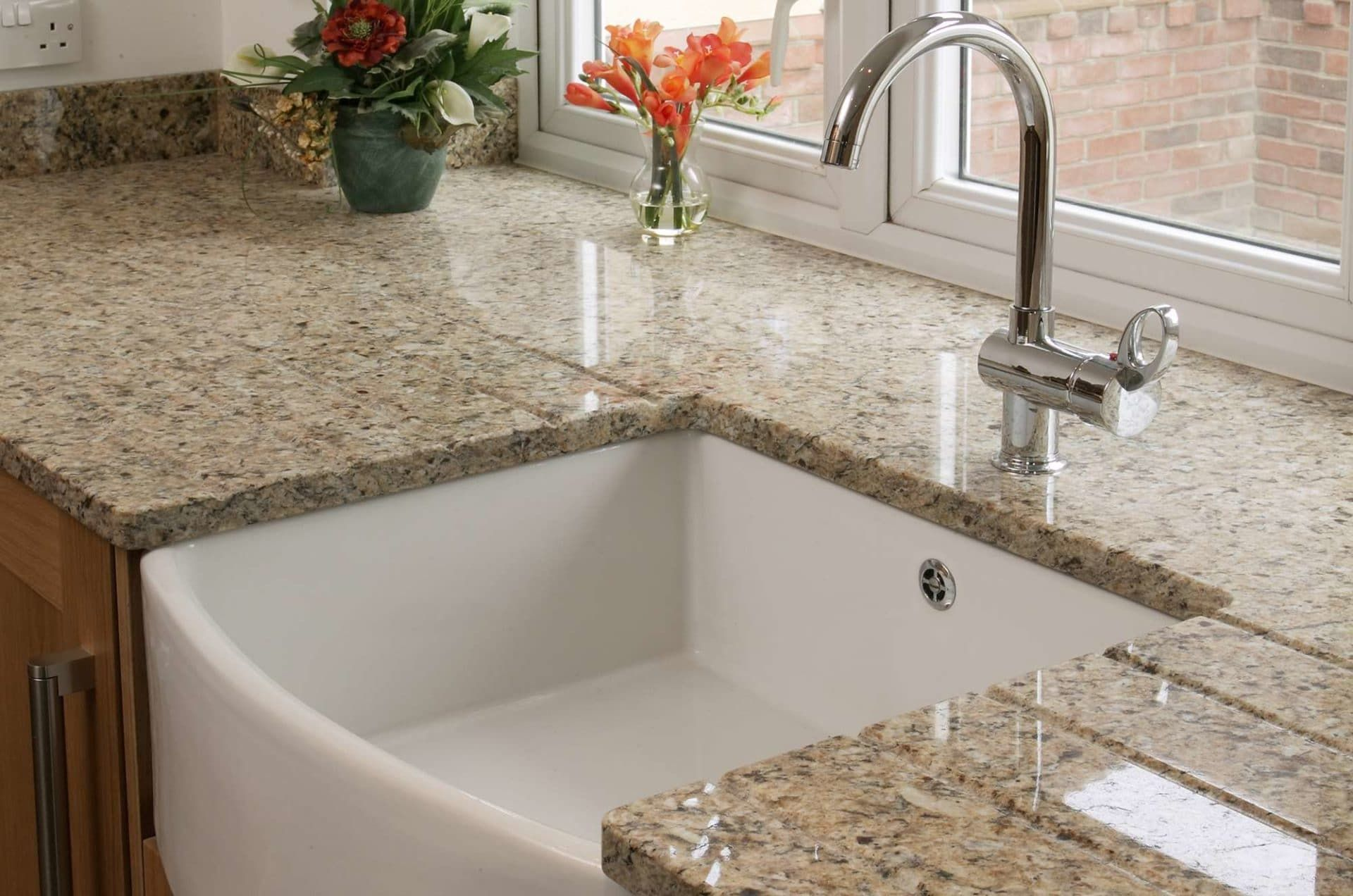 Mortise sink in the windowsill marble kitchen top