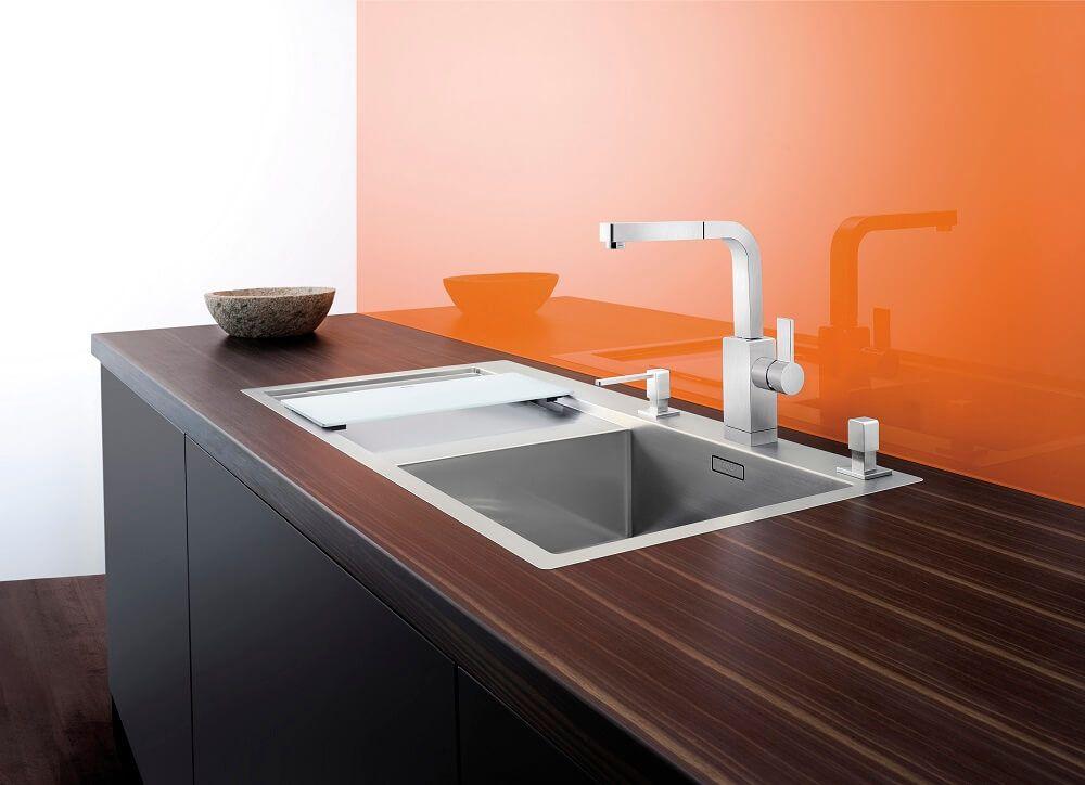 Orange plastic backsplash and strict dark wooden countertop