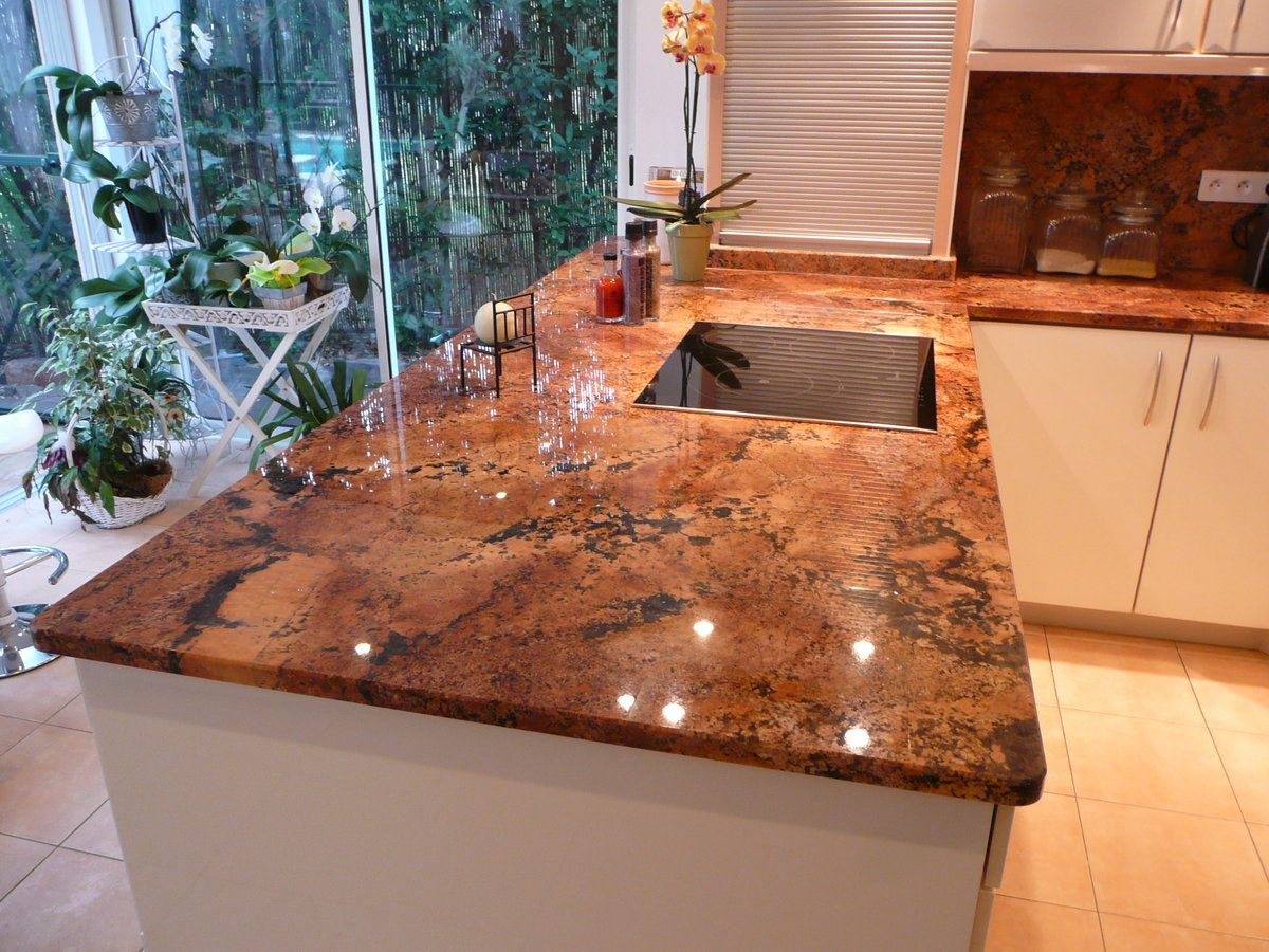 Kitchen Countertop Types, Design Options, and Usage Parameters. Laminated marble top in the casual styled kitchen with white furniture