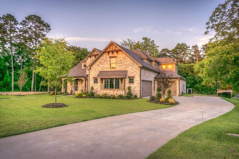 6 Ways to Make the Exterior of Your House Look Better. Nice stone cladded house with dark roof