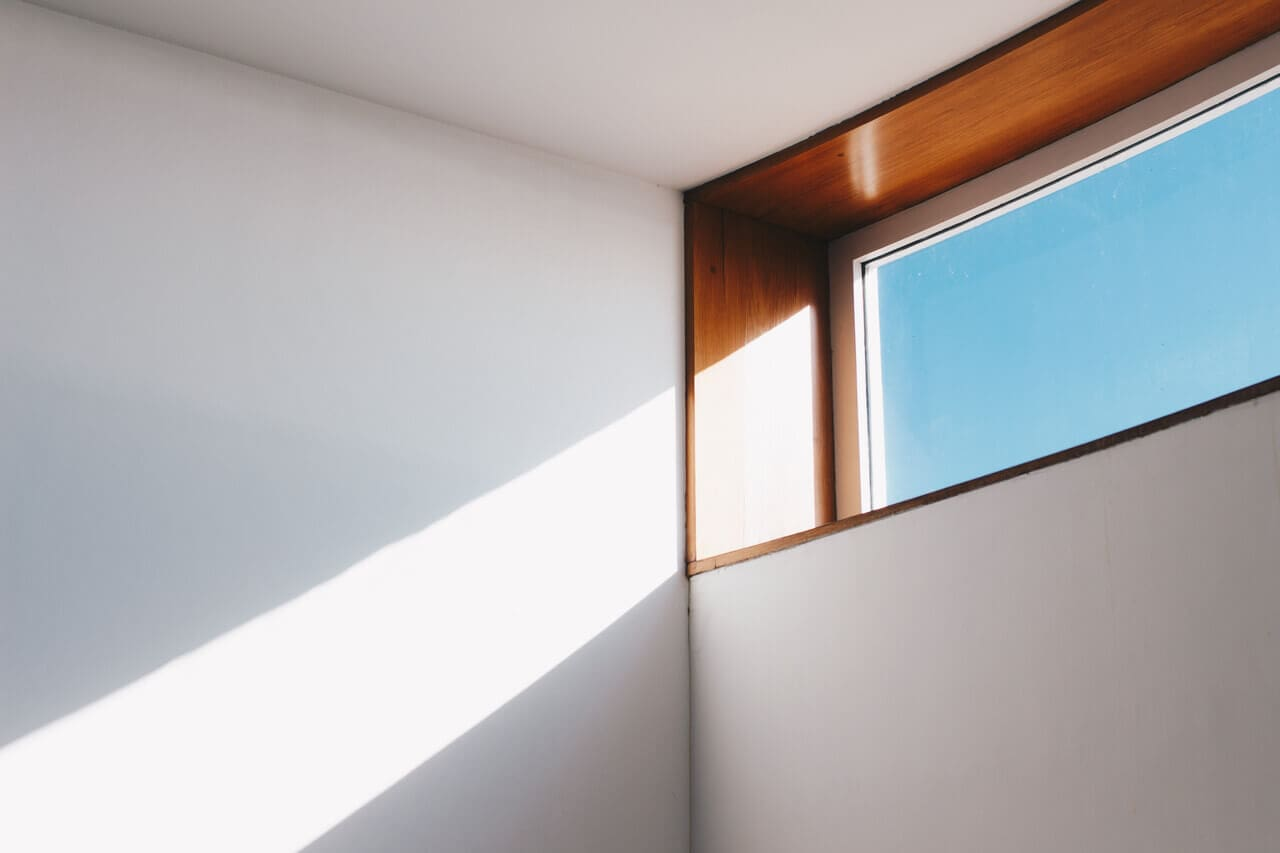 Effective Ways To Maximize The Light Flow Into Your House. Wooden frame of the window in the totally white interior