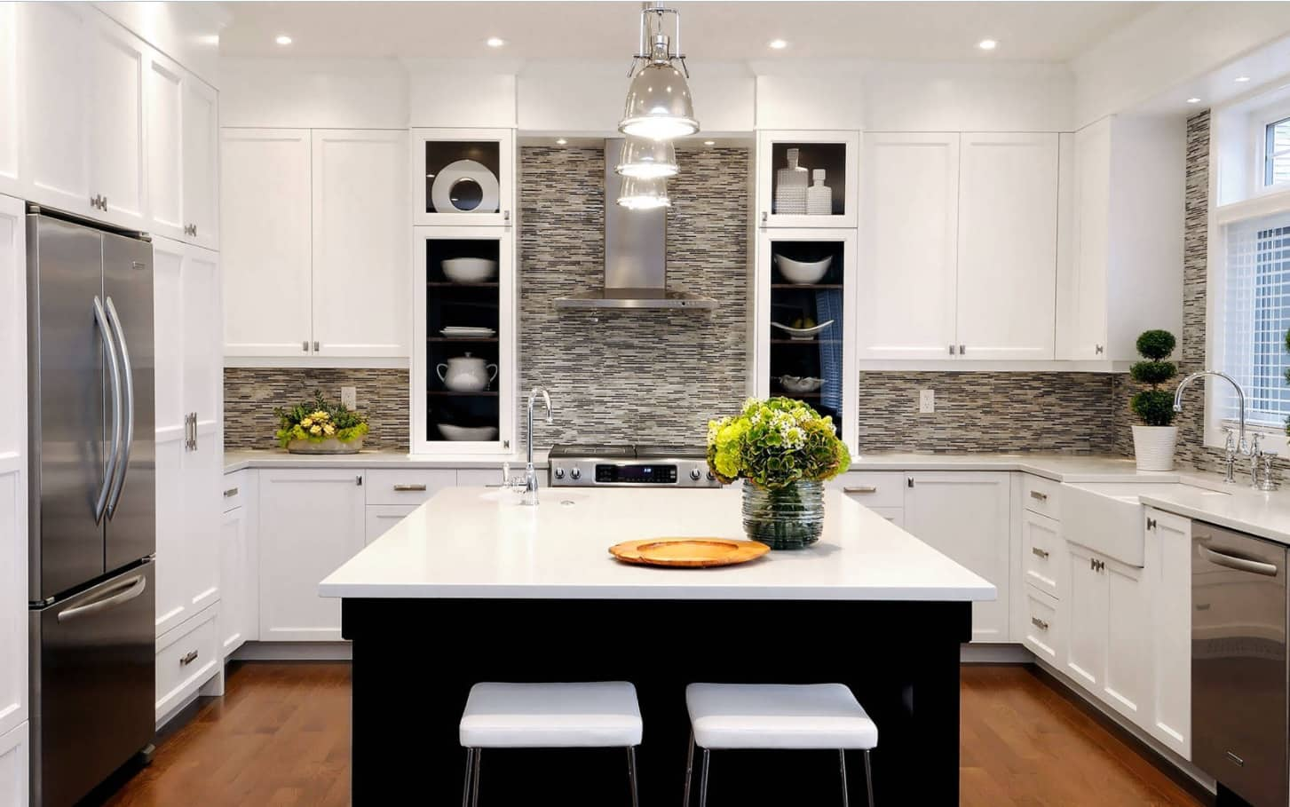 How Mosaic Tile Backsplash Adds Value To Our Kitchen Interiors. Black and white contrast for contemporary kitchen with masterful lighting and gray mosaic