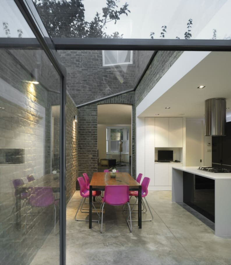 The Benefits Of Renovating Or Extending A Home. The part of the kitchen extended by glass panels and metal contructions looks stunning