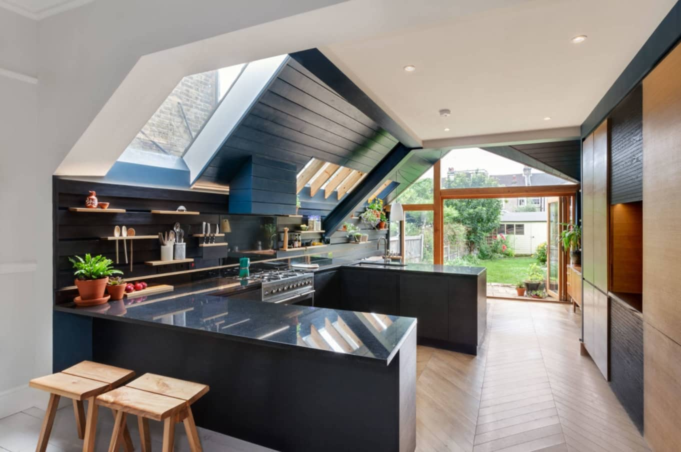 The Benefits Of Renovating Or Extending A Home. Dark color theme in the modern styled summer kitchen