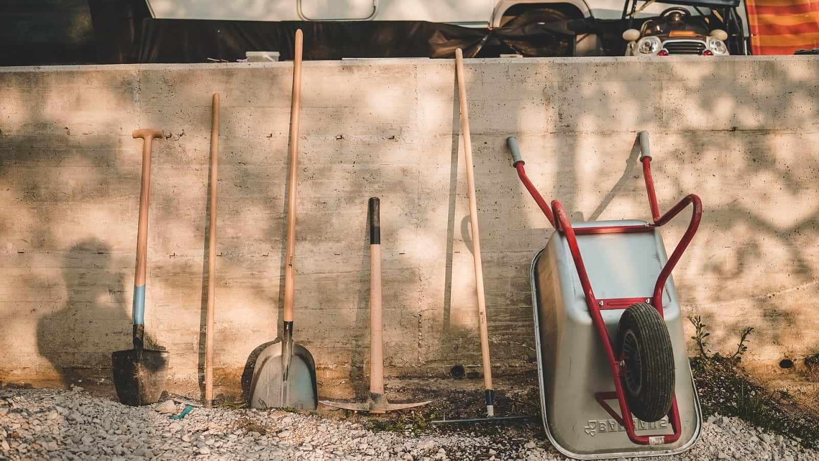 How To Find The Top Gardening Gear And Make Your Job Easier. Instruments at the wooden fence