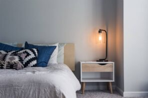 Stunning Ideas To Transform Your Bedroom Style In 2021. Casual styled bedroom with matte white walls and simple bed decorated with pillows