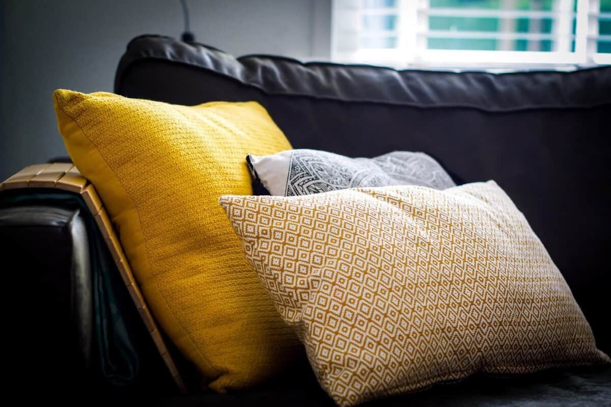 Stunning Ideas To Transform Your Bedroom Style In 2021. Dark sofa with colorful pillows