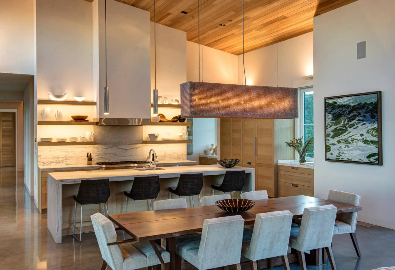 8 Beautiful Ways to Improve Your Home. Grandeur kitchen design in pastel colors, full of chairs and with open shelves backlight