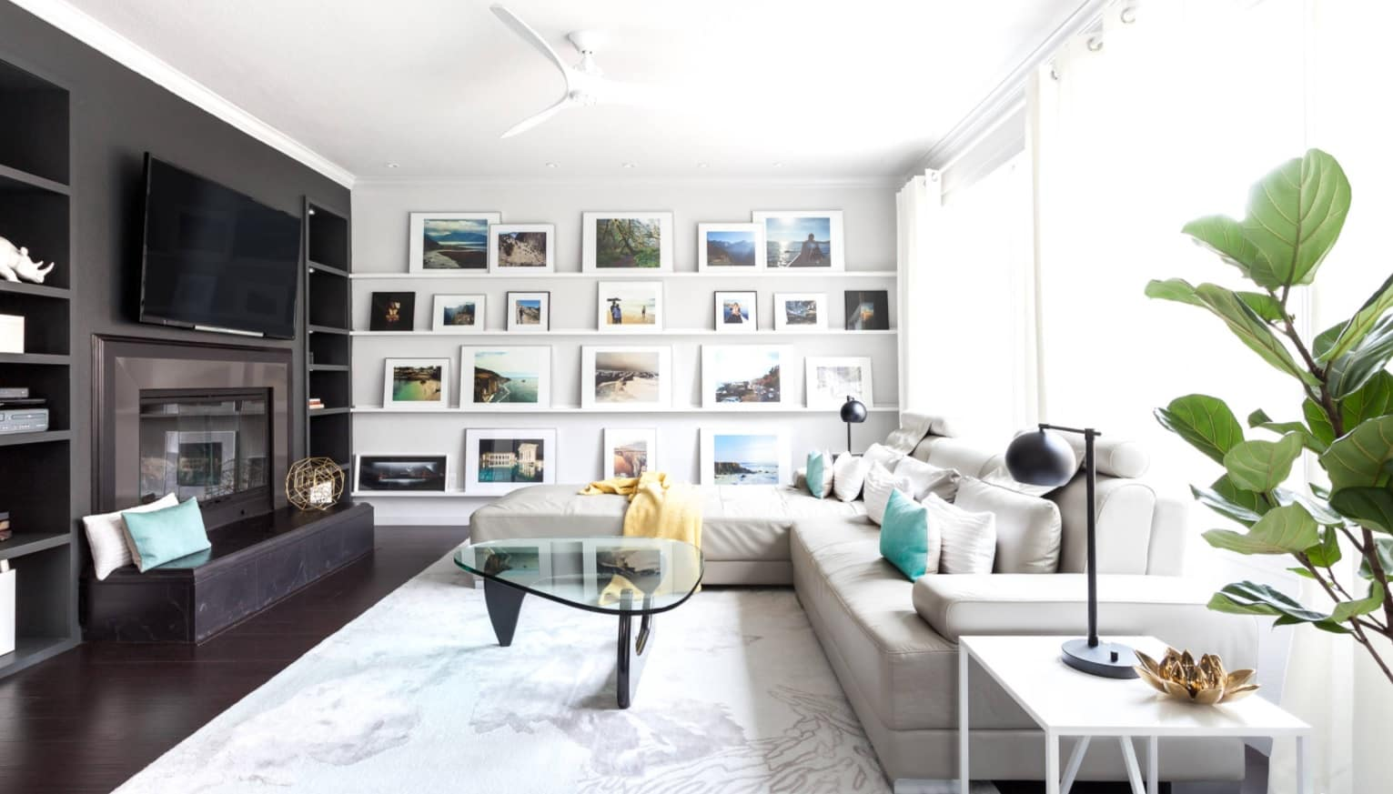 8 Beautiful Ways to Improve Your Home. Homey atmosphere in contemporary designed living room with large angular sofa, fluffy rug, glass coffee table and pictures at the focal wall