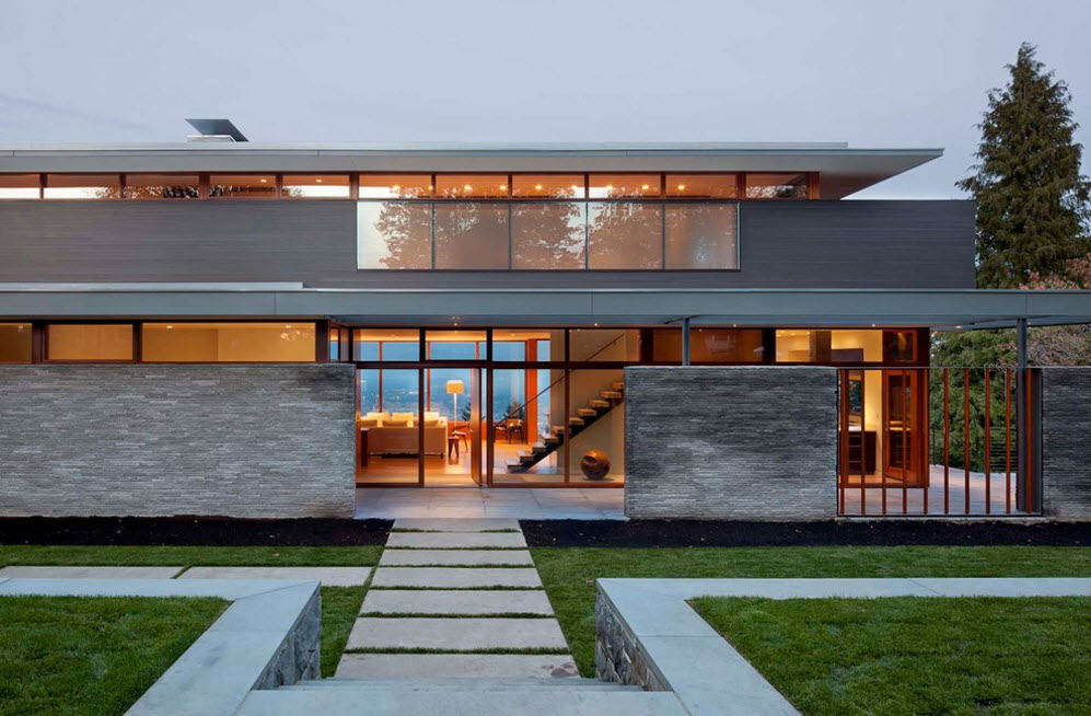 Constructivism in every line of the modern high-tech designed house with stone and cement cladding