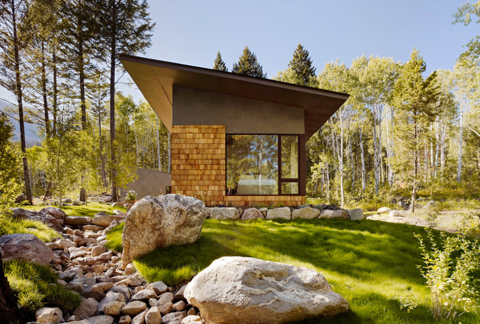 Geometrical forest high-tech house in bright granite and amber facades