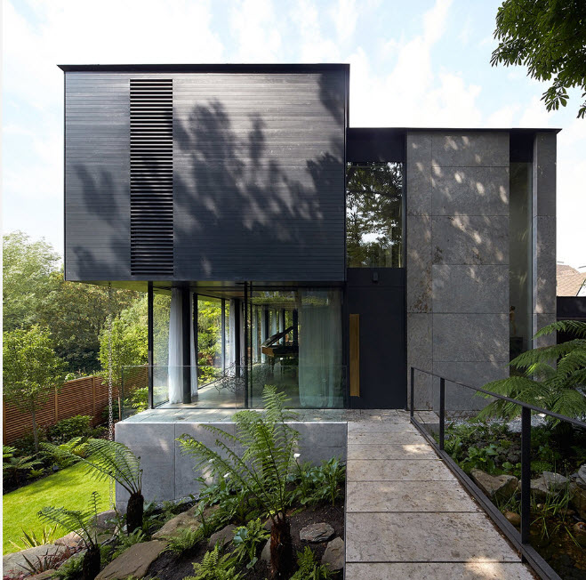 Dark gray top and mild gray concrete basis of the high-tech house