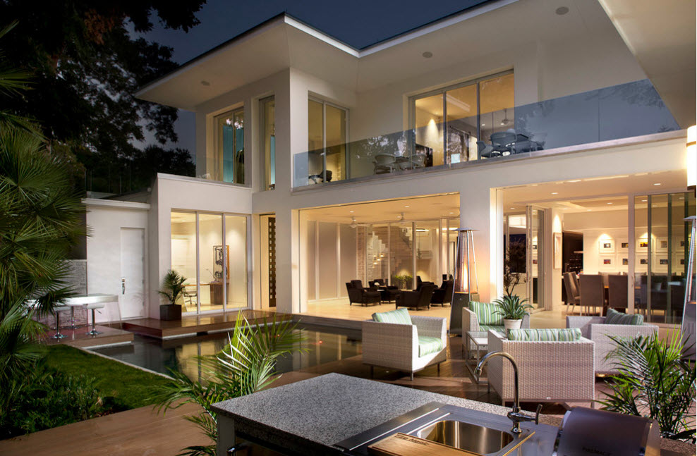 High-tech Style Houses: Fresh Ideas for Individual Projects. Totally white exterior and mild lighting of the cottage with lounge zone