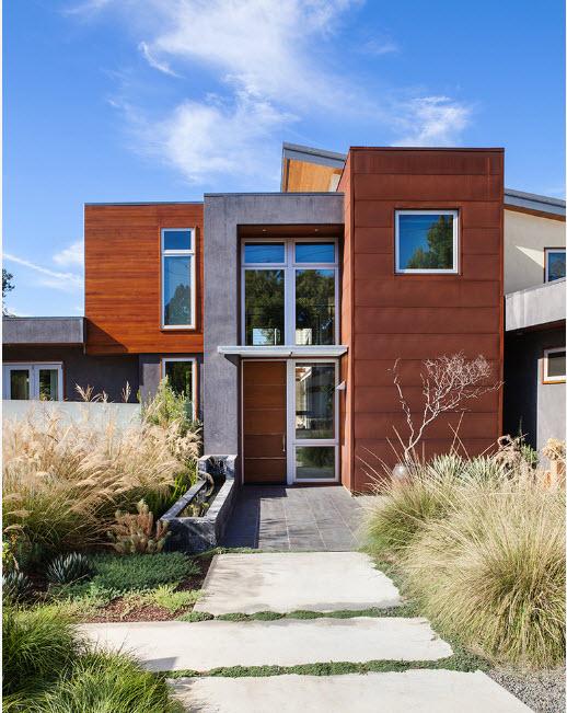 Nice symmetrical high-tech designed house with abundant greenery on both side of the entrance