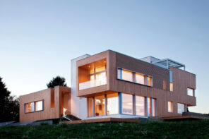 Wooden design of the high-tech house with panoramic windows and box forms of the stories