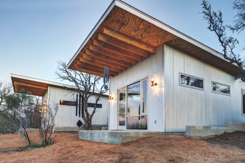 Great far protruding wooden roof on vertical boards for metal sided house