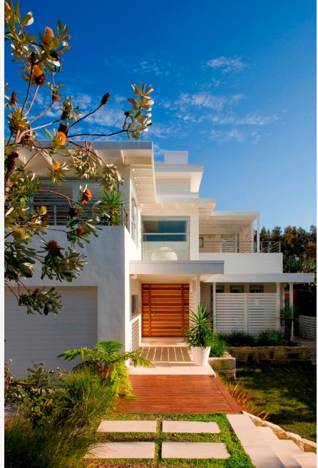 White eco friendly simple house with high-tech influence in strict lines and forms