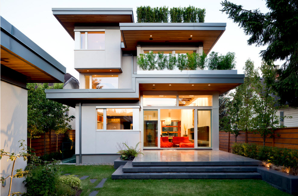 High-tech Style Houses: Fresh Ideas for Individual Projects. Eco house exterior with plants in all white