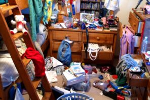 It's Time to Let Go. Learn How to Get Rid of Clutter Fast! Stuffed and littery dorm room with bunk bed and old wooden dresser