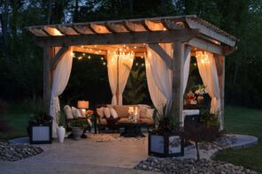 Top 5 Advantages of a Pergola. Wooden canopy with tulle curtains and cozy outdoor furniture and pillows