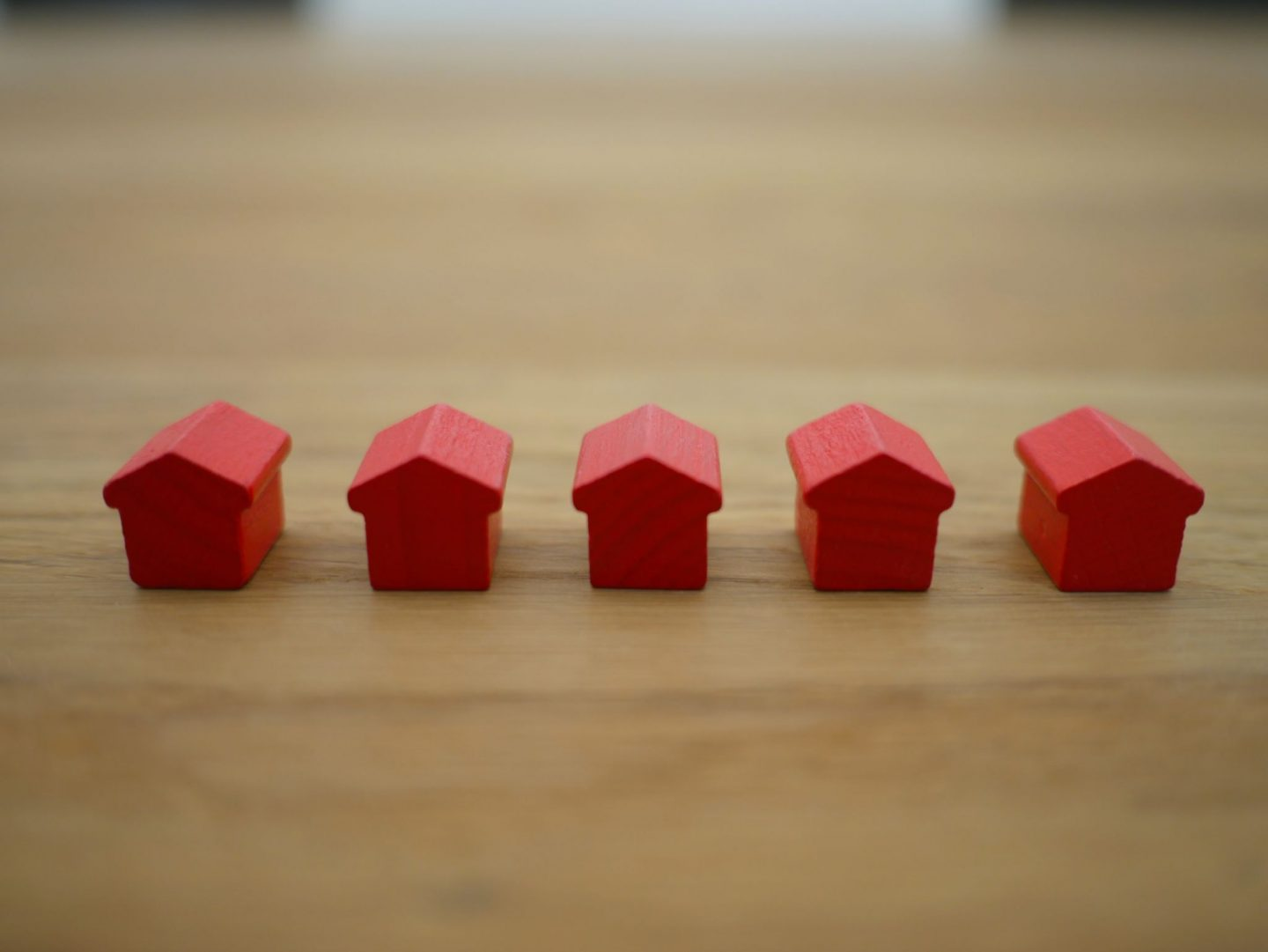 When Is The Right Time To Sell Your Property: Very Important Tips. Red plastic house figurines